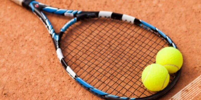 Which grand slam tennis tournament is played on red clay courts?